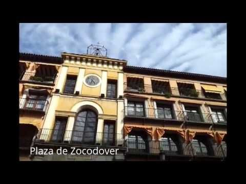 """Places to see in ( Toledo - Spain ) Plaza de Zocodover  Plaza de Zocodover ( The Zocodover Square ) is a square in the city of Toledo  in the autonomous community of Castilla-La Mancha  Spain . Plaza de Zocodover was the nerve center of the city for most of its history acting as the main square of it. A part of Plaza de Zocodover was designed by Juan de Herrera at the time of the reign of Philip II .  The name Zocodover comes from the Arabic Sūq ad-dawābb  which means """"market workhorses""""…"""