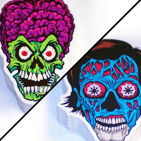 A sticker of both a mars attacks alien and they live stickers are roughly 3