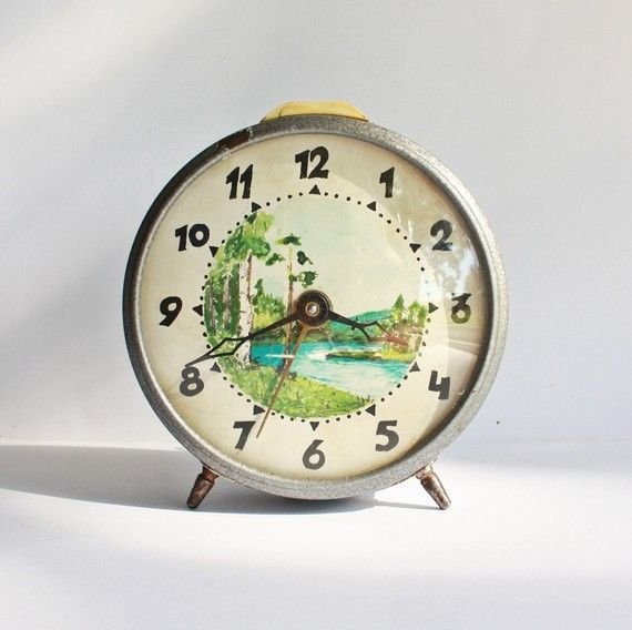 Vintage clock with river scene