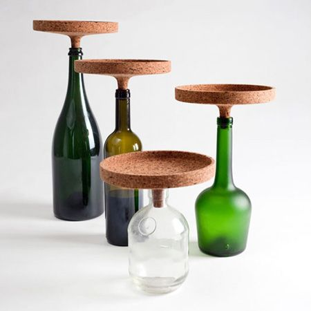 Milan designer Carlo Trevisani has created a cork product that transforms empty wine bottles into table centrepieces.