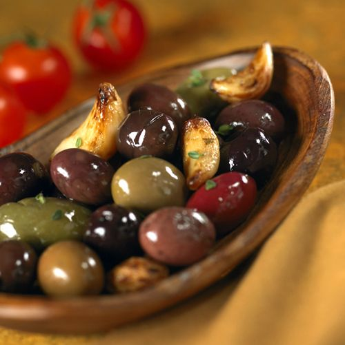 Toss store-bought mixed olives with roasted garlic cloves, fresh rosemary sprigs, sea salt and red pepper flakes; heat, covered with foil, until warm. Serve with toothpicks.