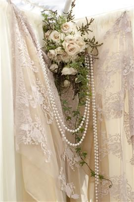lace, pearls and roses.