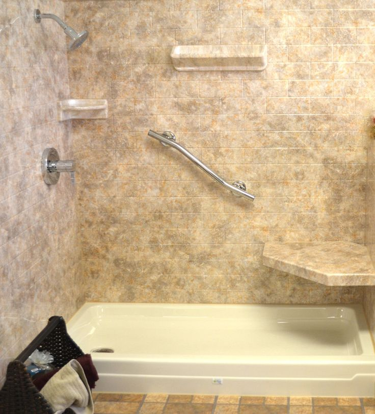 This may look like a tiled shower, but it's acrylic. The best of both worlds in one affordable installation.  read : Acrylic Shower Walls vs. Tile Shower Walls  http://fivestarbathsolutions.com/acrylic-shower-walls-vs-tile-shower-walls/