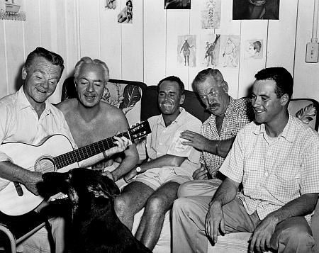 Jimmy Cagney leading the pack in a song during shooting for Mr Roberts (1955) - L-R Jimmy Cagney, William Powell, Henry Fonda, Ward Bond and Jack Lemmon
