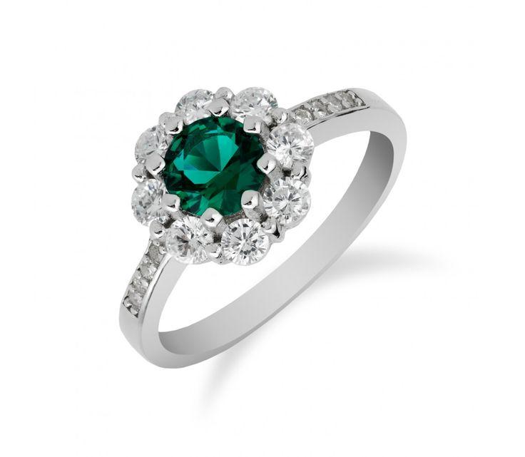Výrazný stříbrný prsten se zirkony a smaragdem uprostřed