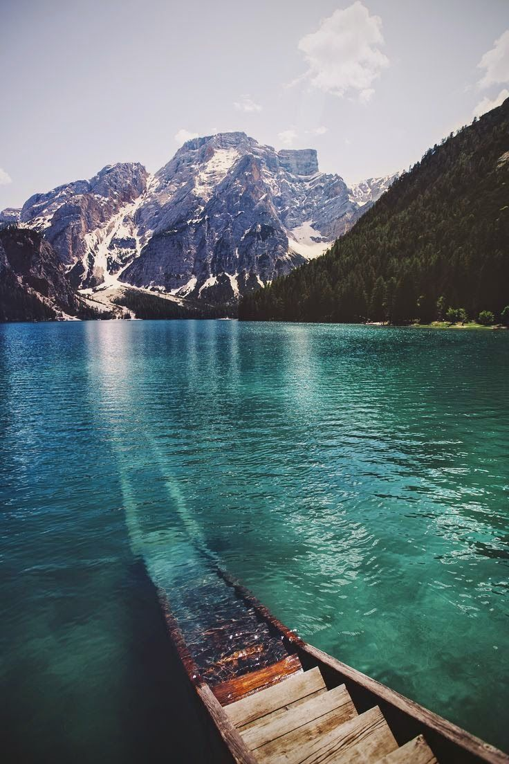 `Lake Braies, Dolomiti, Italy The color of that water alone is just gorgeous.