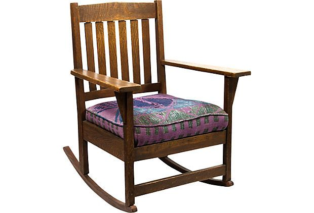 Bill and I bought a very similar rocker for $80 at his parents' auction many years ago.  Mission-Style Oak Rocker on OneKingsLane.com  $655