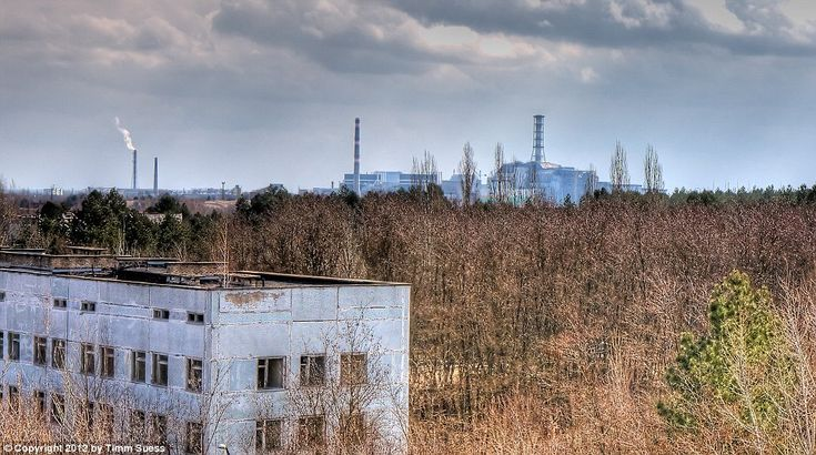 Chernobyl's Abandoned Hospital: The nuclear power plant can be seen in the distance over the hospital's rooftop