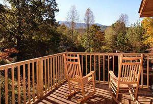 Rocking chairs on the deck of the Hidden Charm cabin in Gatlinburg TN