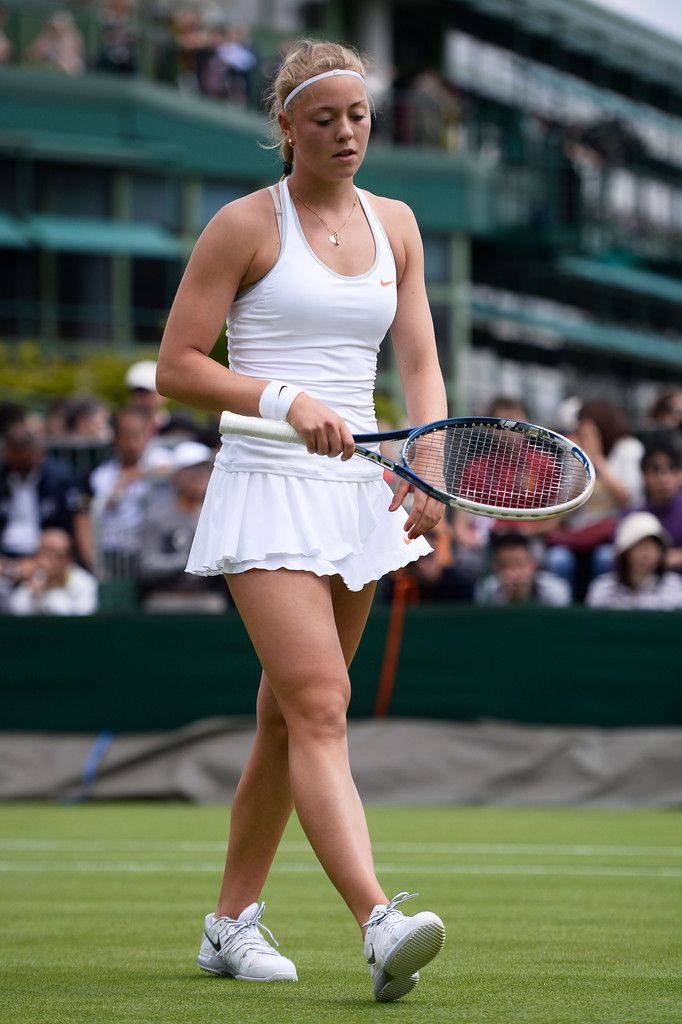 Carina Witthoeft of Germany walks back to her seat during a break in her Ladies' Singles first round match against Kimiko Date-Krumm of Japan on day two of the Wimbledon Lawn Tennis Championships at the All England Lawn Tennis and Croquet Club on June 25, 2013 in London, England.