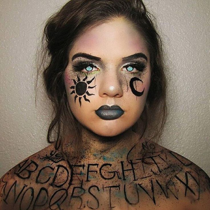 Be sure to grab an off the shoulder top if you're going to attempt this gloriously grungy Ouija makeup courtesy of loveandthebeests. The letters really speak for themselves (or for someone else).