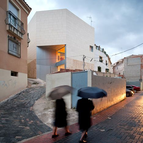 Madrid studio Exit Architects designed this concrete sculpture museum behind the retained facade of an old house in southern Spain.