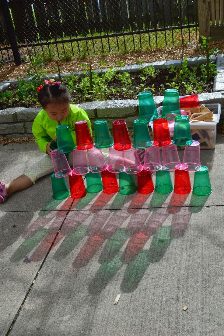 This creative outdoor math and science activity is interesting, on many levels.  The cups are beautiful in the sunlight,  inspiring design work and pattern-making.