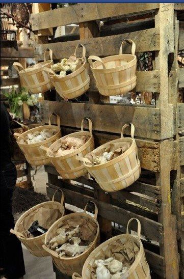 Pallets attached to wall with hooks for hanging.  Loose parts storage