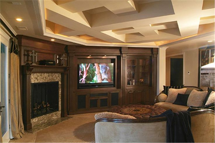 Like the built in wood wall w/inlay for tv.  Like tray ceiling but not the geometric config.  180-1043: Home Interior Photograph-Media Room  http://www.theplancollection.com/house-plans/home-plan-28892