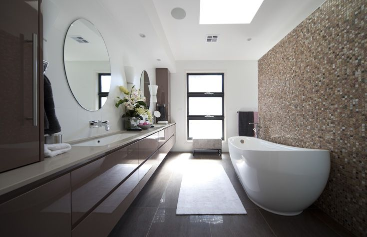 Better Building Kingston - Natural stone look porcelain tiled floor paired with Bisazza glass mosaics