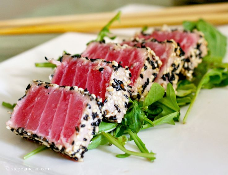 Super easy seared ahi tuna!!  •1 Ahi tuna steak (about 8 oz. or 1/2 pound)   •2 Tablespoons of black sesame seeds   •2 Tablespoons of white sesame seeds   •Kosher Salt   •Olive oil (or vegetable oil) for frying   •Optional: (Arugula tossed in olive oil, balsamic vinegar, salt and pepper), Teriyaki sauce, soy sauce and wasabi