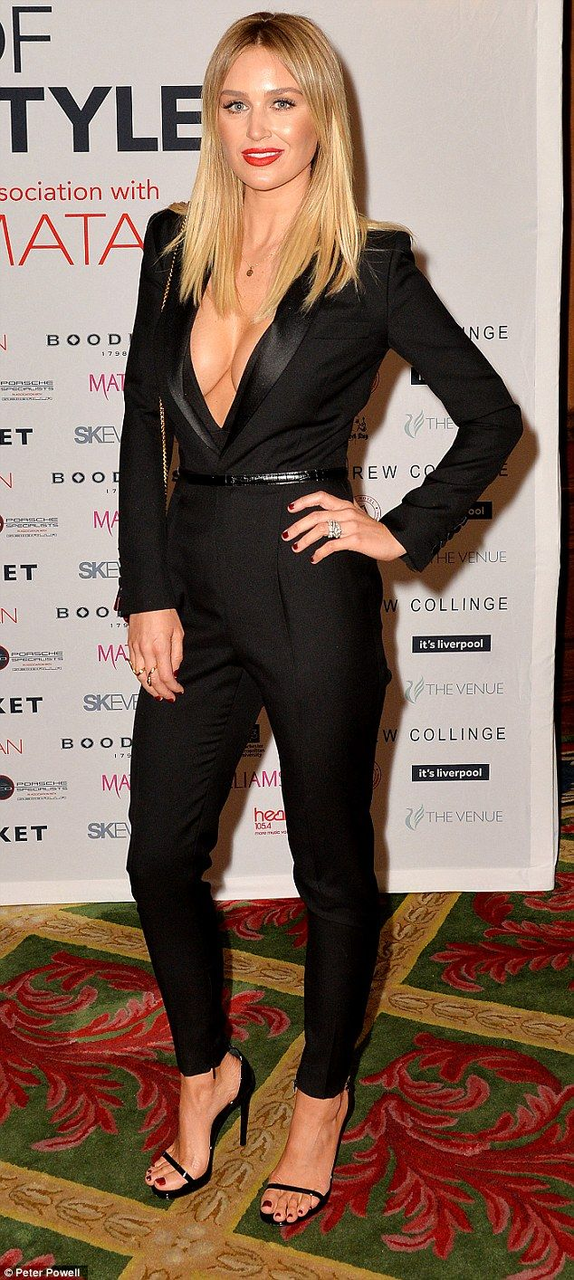Tailor-made: Alex Gerrard shows off her ample assets in a plunging tuxedo style black jumpsuit on Thursday