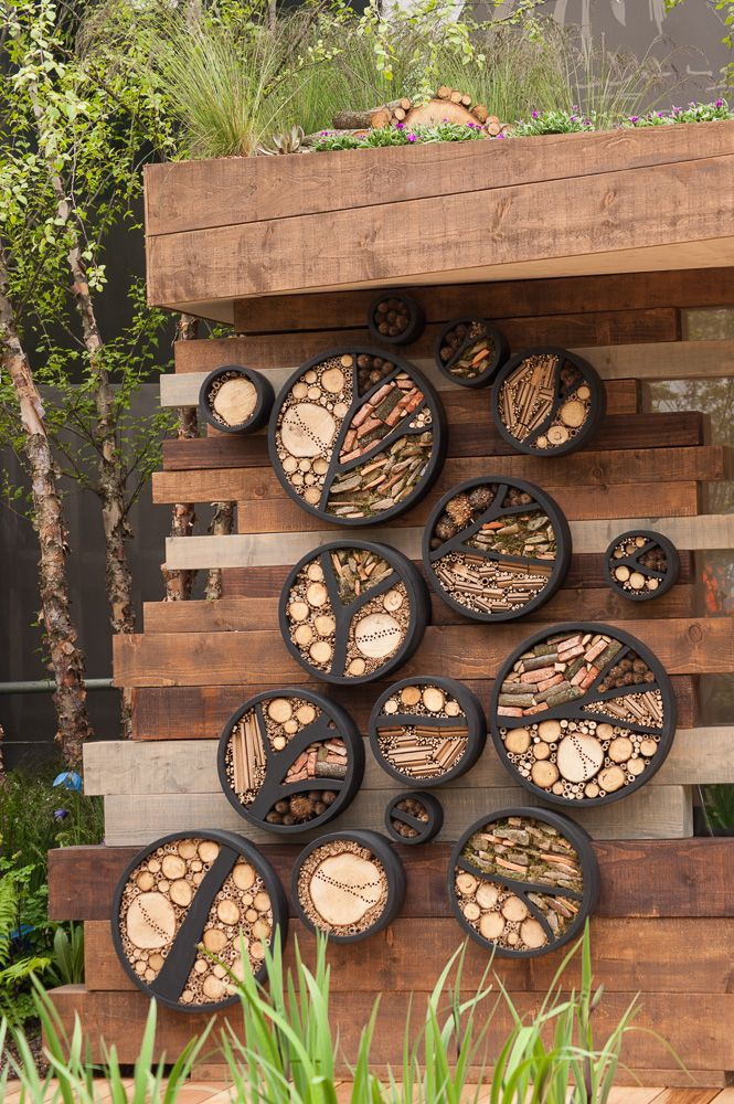 Insect hotels. RBC Blue Water Roof Garden RHS Chelsea Flower Show 2013. Click to read article and to see plants list used.