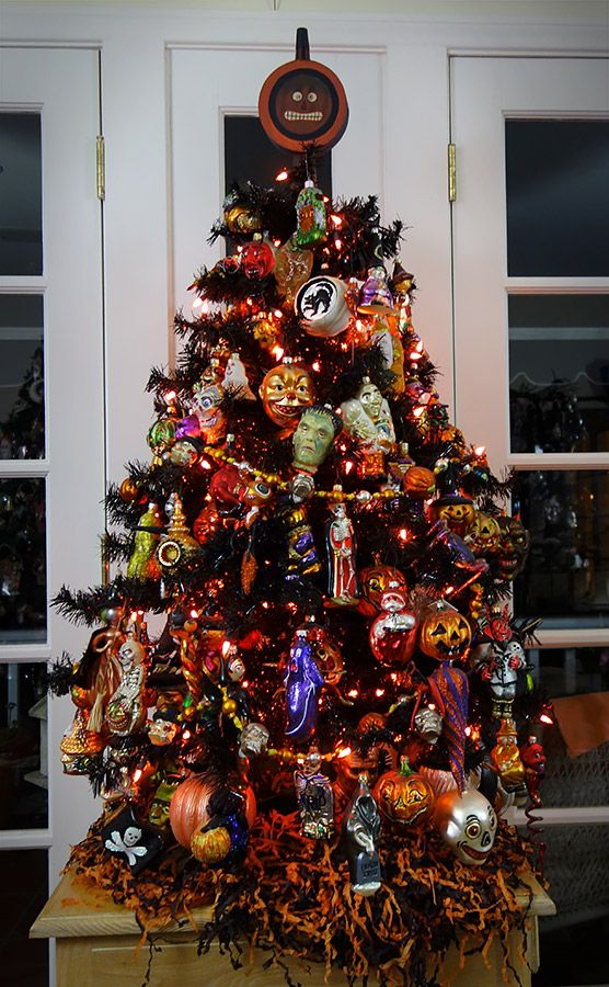 A black Halloween tree filled with Old World Christmas, Slavic and Radko Halloween ornaments.