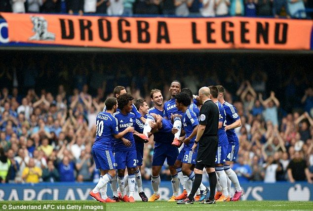 Didier Drogba is carried off by his Chelsea team-mates after suffering an injury in the first half