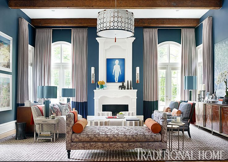A sofa, a daybed, and a pair of spooled-wood armchairs make up