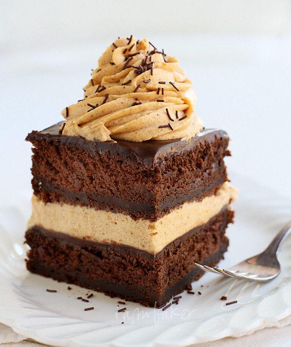 Chocolate Pumpkin Cake with homemade pumpkin whipped cream and layers of milk chocolate ganache.  #recipe #baking #fall #autumn #thanksgiving #dessert #pumpkin #chocolate #cake