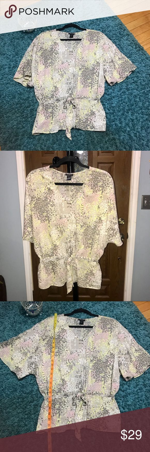 ANN TAYLOR Silky Pebble Print Dolman Sleeve Blouse FEATURES •Ann Taylor Blouse •Sz Small  •Color: Cream, Yellow, pink, Gray, white  •100% Polyester  •Machine washable  •Pebble Print  •Dolman Sleeve  •Adjustable Bow on the front •Loose fit •Elastic Waist to define it. Ann Taylor Tops Blouses