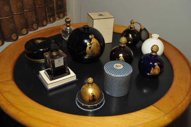 Scandal and Arpege perfume bottles.