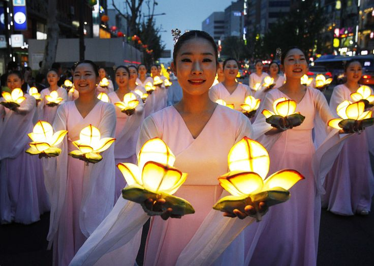 Buddhists carry lanterns in a parade during the Lotus Lantern Festival in Seoul, Korea to celebrate Vesak, the Buddhas birthday