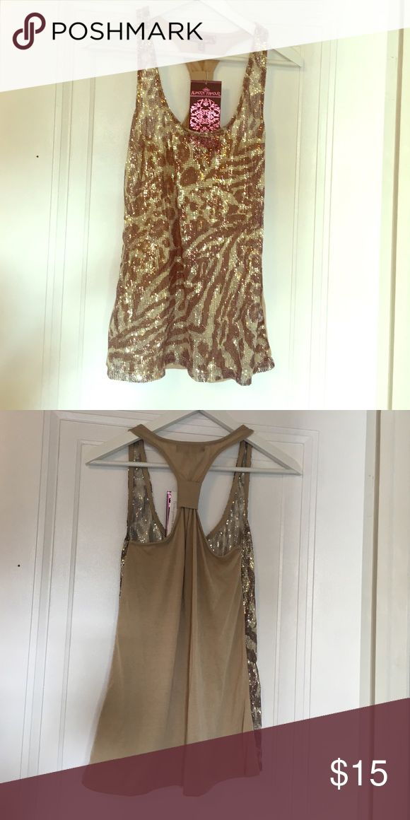 Almost famous sequence tank. Size s. New with tags Brand new tank top perfect for the holidays! Sequence animal print in the front with a solid tan racerback. Almost Famous Tops Tank Tops