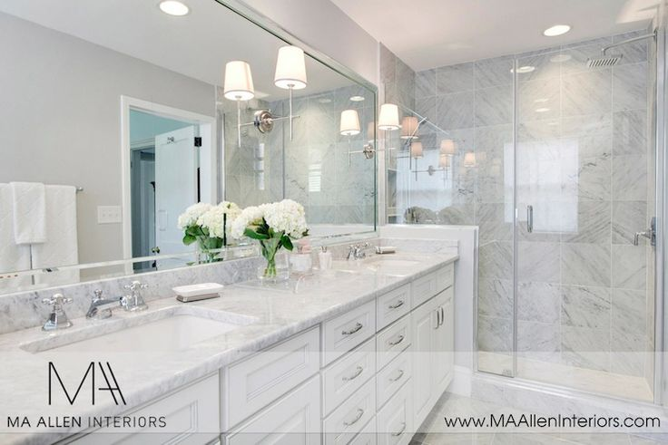 MA Allen Interiors: White and gray master bathroom with gray walls framing white double vanity and marble ...