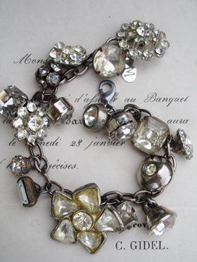 Vintage Rhinestone Button Bracelet Number 16  This bracelet has all vintage rhinestone buttons. There are so many different varieties and sizes, some with lacy bezels, some with clean setting and no prongs, some with gold tone settings, most with silver, all with various signs of age (which we love!)!