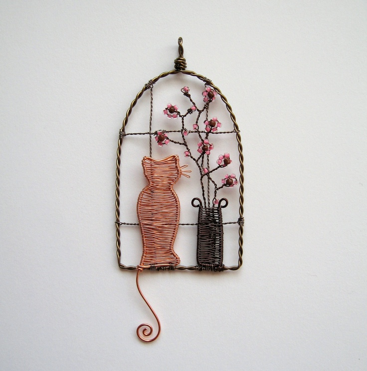 Watching The World Go By wire wrapped cat pendant decoration ornament with cherry blossom. £42.00, via Etsy.