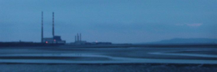 A photograph by photographer Niall O Cleirigh of The red and white chimneys in Sandymount Dublin 4 Ireland early evening blue light www.essentia.ie