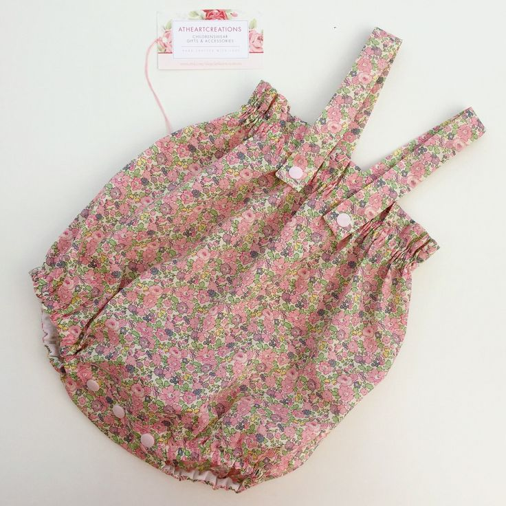 Stunning Liberty print Betsy Ann in pink used for a delightful summer romper suit