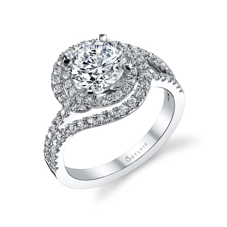 Style# S1121 Classic Swirl Engagement Ring - This exquisite engagement ring features graceful swirls of white gold, diamond accented ribbons encircling a 1 carat round brilliant diamond center. Each diamond swirl comes to an end and the ribbons begin to create a sparkling split shank with a total of 0.65 carats. https://www.sylviecollection.com/classic-swirl-engagement-ring-s1121