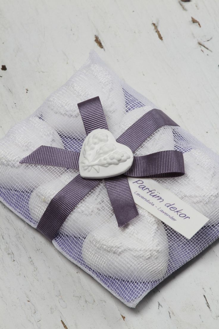 Hand Crafted Lavender Clay Hearts resting in Gorgeously boxed white mesh and purple ribbons. Authentic French lavender scent spiked with organic lavender essential oils