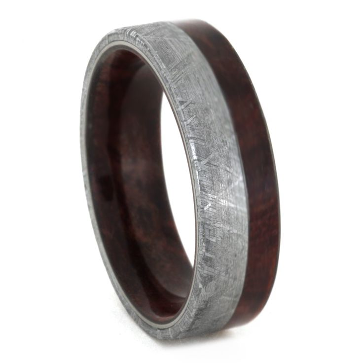 This meteorite wedding band shows off some minimalist style with an offset wood inlay. Wear the beauty of gibeon meteorite's widmanstatten pattern with a...