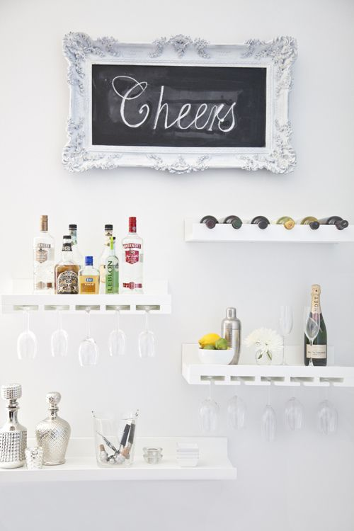 Really cute bar display idea for the wall, perhaps in a living room or dining room space installed above a table or dresser.