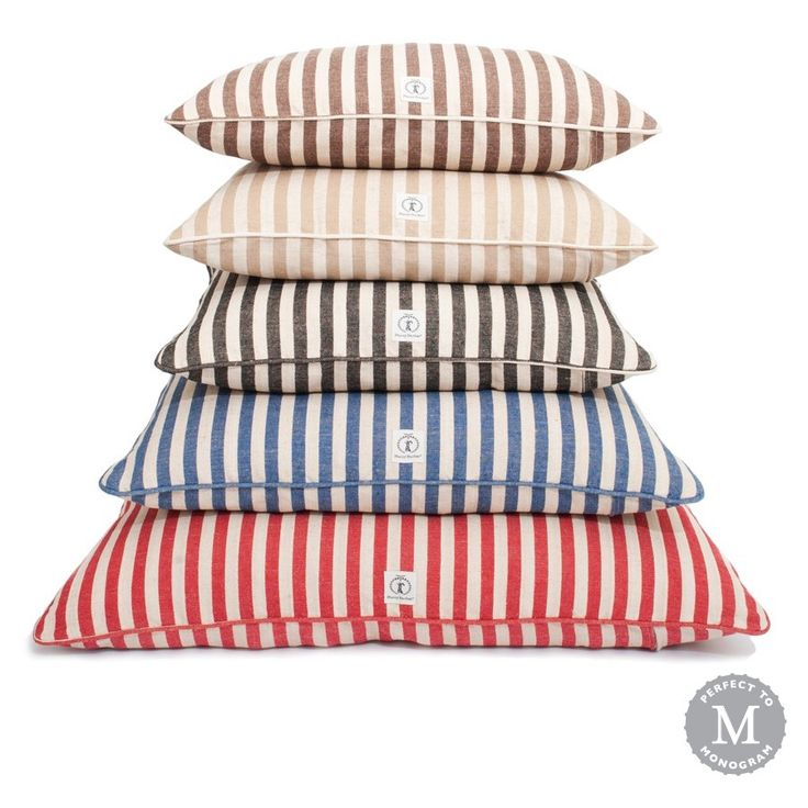 """Our vintage-inspired striped dog beds have serious nostalgic appeal. Made from a jute-polyester blend, each cover is machine washable and comes preshrunk. Thick dog bed inserts provide plenty of padding for weary pups and are stuffed with eco-friendly fiberfill made from recycled plastic bottles. Small Dog Bed 24"""" X 30"""" Medium Dog Bed 30"""" X 36"""" Large Dog Bed 36"""" X 44"""" Personalization Information *Font is capitalized."""