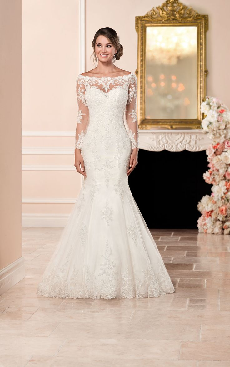 This satin fit & flare long-sleeve wedding dress from Stella York features an embroidered lace bateau illusion neckline, sleeves & back |@BridalPulse Wedding Dress Gallery | Stella York Collection | Floor Ivory Mermaid / Trumpet Off The Shoulder $$ ($1,001-2,000) – Jade Bishop