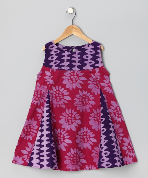 This darling batik dress was handmade by talented female artisans in Ghana. The vibrant color palette looks pretty on any little girl while the original hand-dyed design makes it a true one-of-a-kind piece. 100% cottonMachine washMade in Ghana