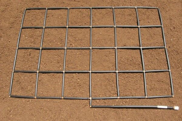 The Garden Grid watering system - 4x6. Waters raised garden at soil level and partitions your raised garden bed into equal planting sections! by GardenInMinutes.com