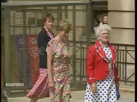 July 17, 1991: Princess Diana and First Lady of the USA at an AIDS Clinic in Middlesex Hospital in London, England. They share a common interest in AIDS patients. Middlesex Hospital, Diana Princess of Wales (Flowery sleeveless dress) and Barbara Bush (wife of US President) walking down the street towards the Hospital. Hospital staff looking out of window and waving. Barbara Bush standing beside male hospital worker, as Princess of Wales and Barbara Bush go into Hospital. Part 2. Video.