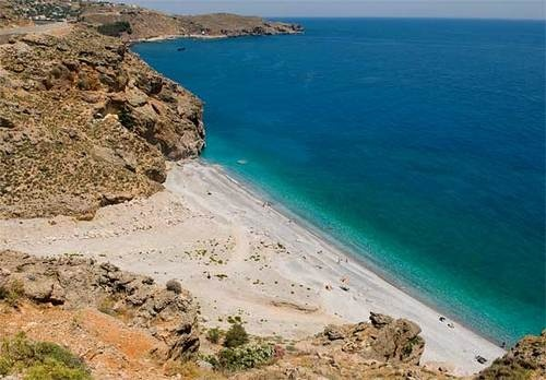 Illigas beach  Iligas is an amazing turquoise-water sandy beach, 1km west of Chora Sfakion and 74km south of Chania. Iligas is located at the end of Kavi Gorge, that starts close to Anopolis.