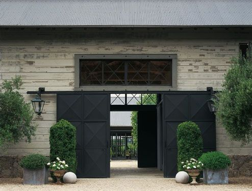 dark grey against pale stone with clipped buxus (boxwood) topiary - original pin note: Napa estate of Barbara Colvin
