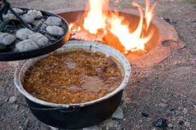 Dutch Oven Peach Cobbler: Prepare this cobbler at your camp site in a cast iron Dutch oven that has a lid with a lip, so that you can place hot coals on the top of the pan.   It's