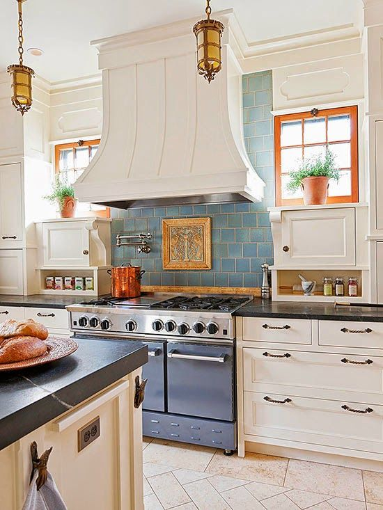 Here is another kitchen backsplash idea from French Country Cottage   with  blue tile & white cupboards.....