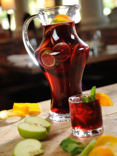Red Sangria: 3-4 oz Spanish brandy     1 oz. simple syrup     1 oz. cranberry juice     1 oz. orange juice     1 squeezed orange wedge     3 oz. red wine     Combine all of the ingredients. Top with a splash ginger ale. Pour back and forth in two glasses until well mixed and serve over ice.